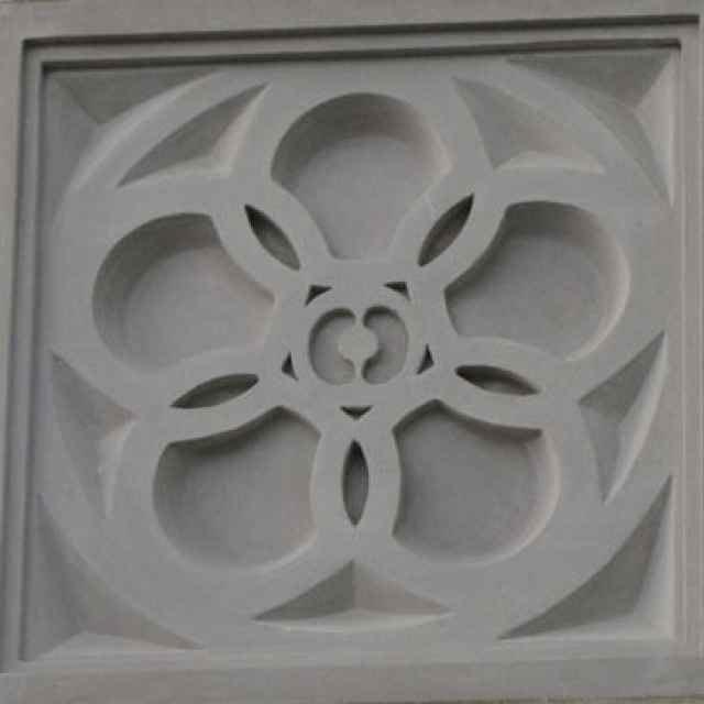 An apple blossom inspired garage medallion.